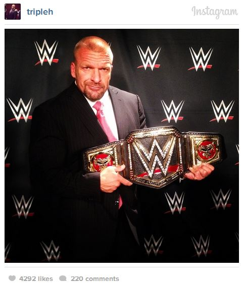 Latest News Update Hhh: Photo Of Triple H Revealing The New WWE World Heavyweight