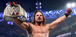 AJ Styles shows off the WWE Championship