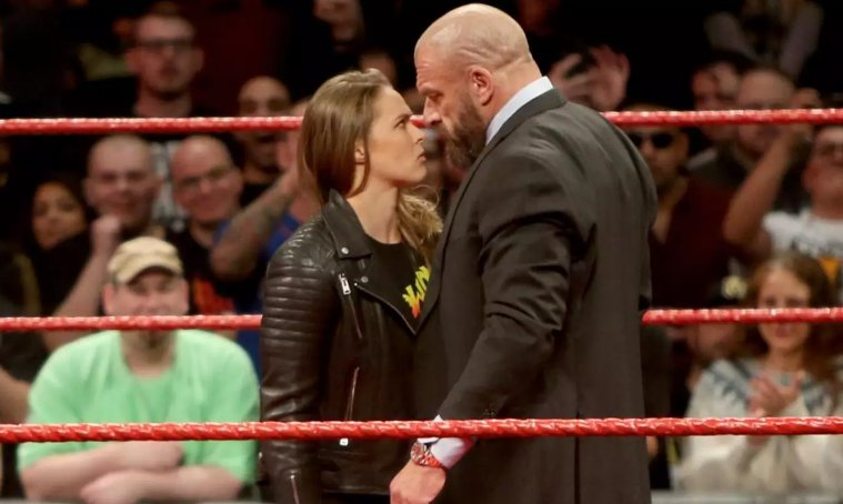 Ronda Rousey makes WWE debut, puts Triple H through a table