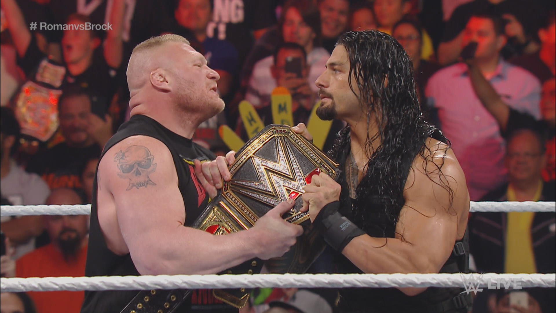 WWE Brock Lesnar and Roman Reigns tug of war